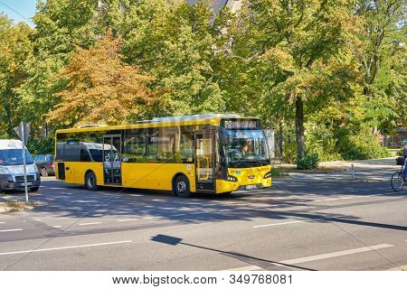 BERLIN, GERMANY - CIRCA SEPTEMBER, 2019: yellow VDL Bova bus seen on a road in Berlin in the daytime.