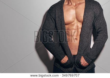 Closeup Of Muscular Man In Unbuttoned Shirt Showing His Naked Torso