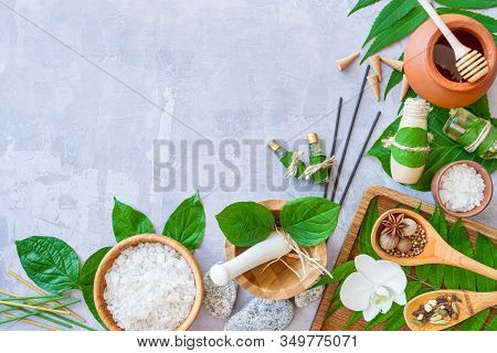Top View Of Set For Relaxing Thai Spa Treatments. Wooden Mortar Pounder With Herbs, Bowl With Salt,