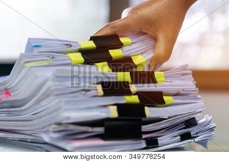 Businessman Hands Working In Stacks Documents Of Paper Files, Searching Information On Desk Office,