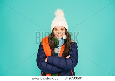 She Feels Confident And Cute. Confident Child Keep Arms Crossed Blue Background. Happy Girl With Con