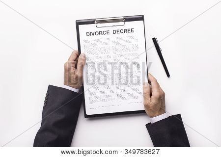 Process Of Signing Divorce Decree. Husband Reading Legal Document About Divorce, White Background
