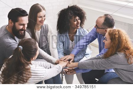 Team Spirit And Cooperation Concept. Group Of Happy People Joining Hands At Therapy Session, Celebra