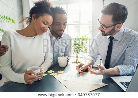 Family Couple Consultations With A Lawyer Or Insurance Agent. Law And Insurance.