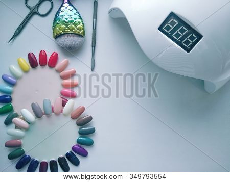 Manicure Tools. Uv Lamp, Scissors, Pusher, Brush And Color Palette. Desktop Manicure. Top View