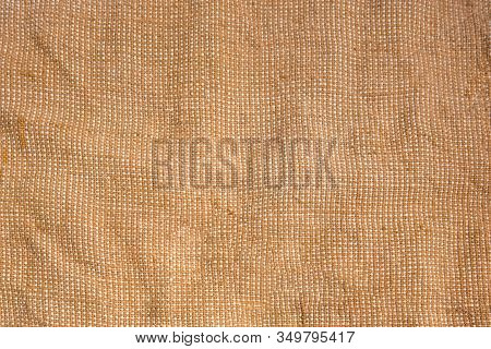 Bagging Fabric Background. Textile Texture Pattern For Backdrops. Coarse Bag Woven Canvas In Brown A