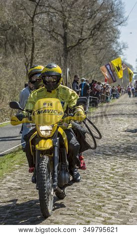 Wallers,france - April 12,2015: The Yellow Technical Bike Of Mavic Driving On The Famous Cobblestone