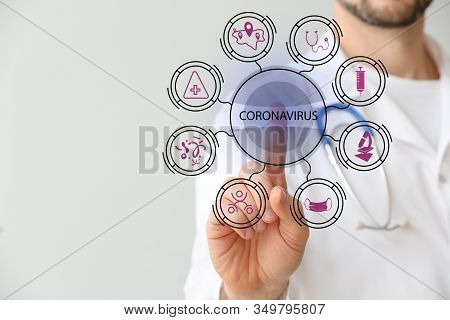 Male Doctor Using Virtual Screen On Light Background. Concept Of Of Coronavirus Epidemic