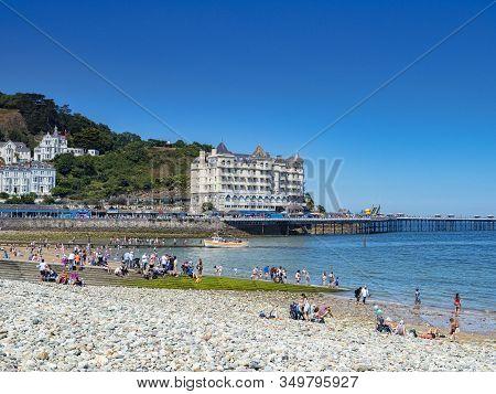 26 July 2018: Llandudno, Conwy, Uk - Llandudno Beach On A Hot Summer Day, And The Grand Hotel. In Th