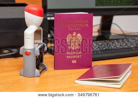 Biometric Passports Of Citizens Of The Republic Of Moldova Of Red And Blue Colors With A Date Stampe