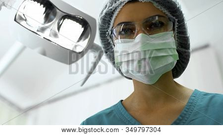 Female Dentist Waiting For Dental Anesthesia Effect, Preparation For Surgery