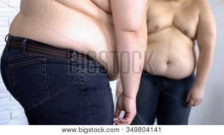 Depressed Obese Man Looking At Fat Belly Mirror Reflection, Weight Loss Problem