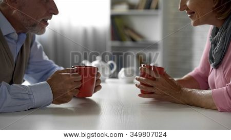Aged Couple Chatting, Drinking Coffee In Cafe, School Sweethearts, Meeting
