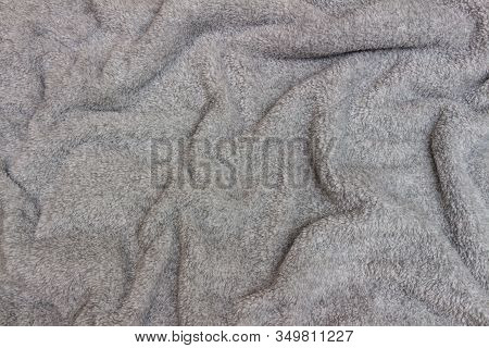 Gray Crumpled Bedspread Texture For Background. Close-up Of Natural Warm Wool Coverlet, Wrap, Coverl