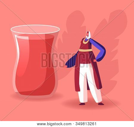 Woman In Turkish Costume Stand At Huge Glass With Traditional Turkey Tea. National Oriental Cuisine,