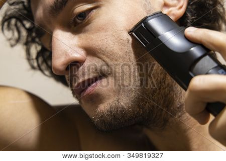 Man Close Portrait Shaving Process Time By Trimmer Morning Ritual Action