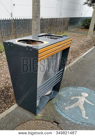 Outdoor Public Trash Sorting Bin With Pedestrian Signage On The Ground.