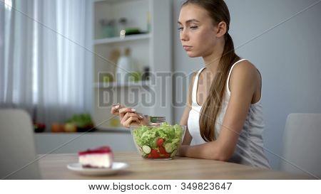 Slim Girl Eating Salad But Craving Cake, Fashion Trend To Be Slender, Diet