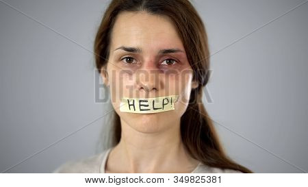 Woman With Help Sign On Taped Lips, Helpless Victim Begging For Support