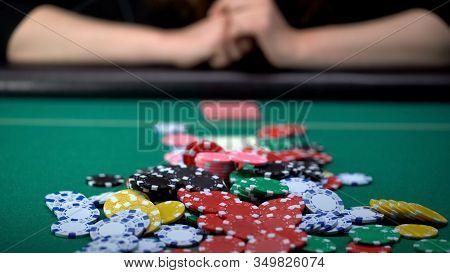 Beautiful Girl Making Risky Bets At Casino Poker Game, Gambling Addiction