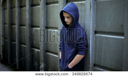 Sad Teen Boy Hiding From Everyone In Backstreet, Adolescent Protest Against Word