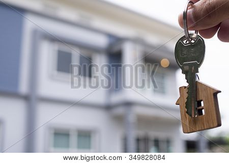 Landlord Unlocks The House Key For New Home.  Real Estate Agents, Sales Agents Home For Sale And For