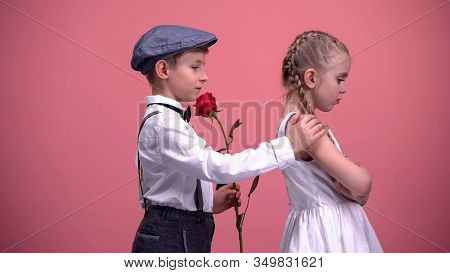 Little Cute Boy With Red Rose Apologizing To Offended Girlfriend, First Love