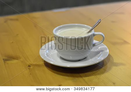 Detail Of Coffee Drink With Spoon On The Table