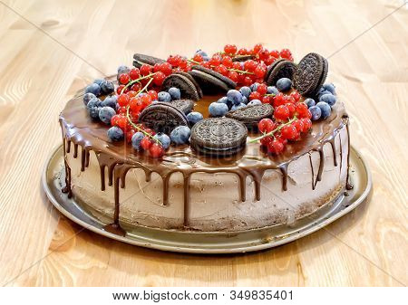 Layer-cake With Chocolate Top And Fruits