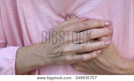 Woman Holding Hands On Chest, Sudden Heart Attack, Health Problem, Emergency