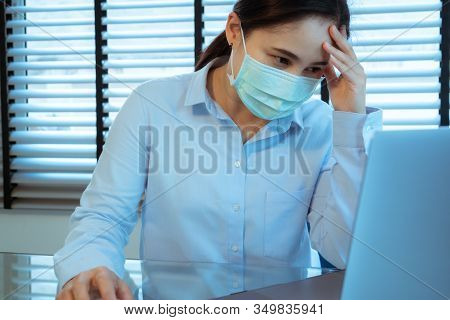 Woman Headache With Face Mask Protection While Working, Coronavirus, Air Pollution, Allergic Sick Wo