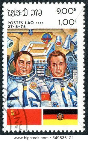 Laos - Circa 1983: A Stamp Printed In Laos, Showing The Crew Of The Soyuz 31 Spacecraft, Valery Byko
