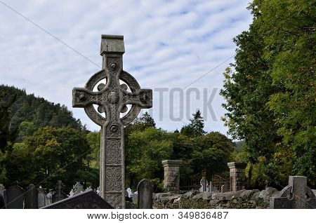 Old Ireland Celtic Stone Cross In Cemetery