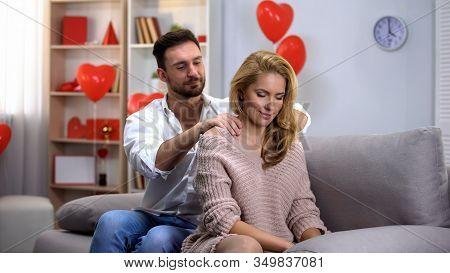 Male Massaging Ladys Neck, Couple Having Foreplay, Celebrating Valentines Day