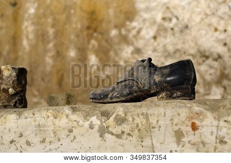Old Shoe Covered With Dust And Ash Underground Of Naples