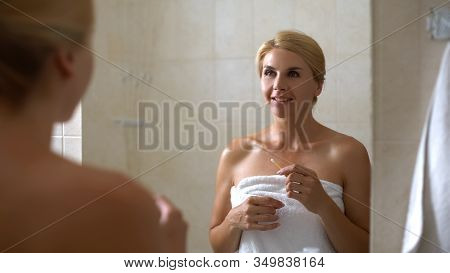 Smiling Woman Holding Cotton Swab At Bathroom, Everyday Hygiene, Cleaning Ears