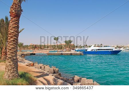 Hurghada / Egypt. 02 August 2018: City Harbor With Moored Boats Ships And Cruise Liners. Ships And L