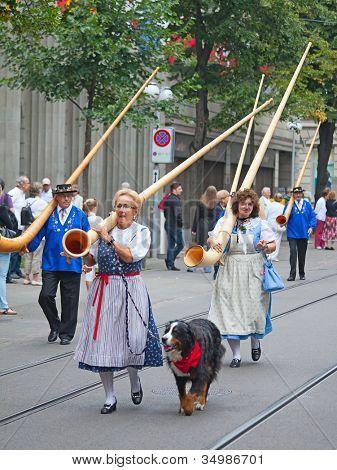 ZURICH - AUGUST 1: Swiss National Day parade on August 1, 2009 in Zurich, Switzerland. Traditional alphorn musicians in a historical costumes.