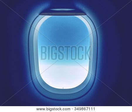 Airplane Window With Copy Space. Blue Sky Window Plane White Cabin. View From The Plane To The Cloud
