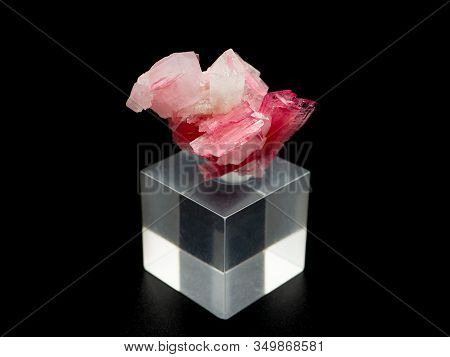 A Pink Rhodonite Mineral On Black Background