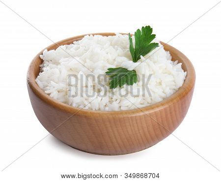 Wooden Bowl With Cooked Rice And Parsley Isolated On White
