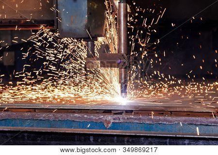 Plasma Cutting Of Metal With A Cnc. Plasma Cutting Machine Cutting Steel Sheet. Laser Cutter In Prod