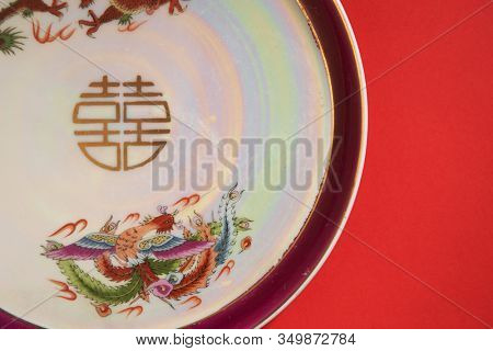 dragon and phoenix Teapot and cups used in traditional Chinese wedding ceremony with chinese sign meaning happinese. Translation: Double Happiness