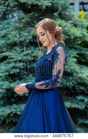 Close Up Portrait Of Beautiful Teen Girl In Beautiful Ultramarine Prom Dress Prom Dress. Glamorous H
