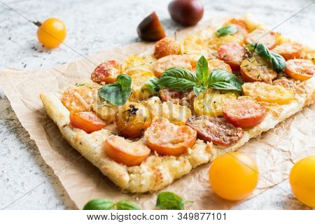 Vegetable Puff Pastry Tart With Colorful Tomatoes Cherry, Cheese And Basil. Vegetarian Healthy Food