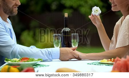 Love Confession Of Middle-aged Man On Romantic Dinner With Woman, Holding Hand