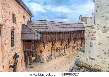 Courtyard Of Medieval Loket Castle (hrad Loket) Gothic Style Building On Massive Rock With Stone Wal