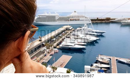 Girl Looking At Cruise Liner From Hotel Terrace, Waiting For Embarkation On Ship