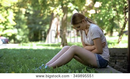 Pale Girl Suffering Abdominal Pain Outdoors, Menstrual Ache Or Indigestion