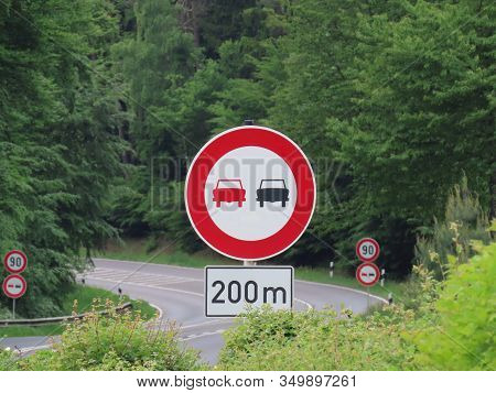 Traffic Sign No Overtaking In 200 M And Further Away Speed Limit 90 Km Per Hour In Forest Before Tur